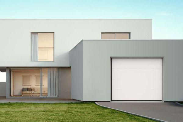Modernes Haus mit Garage und weißem Sektionaltor